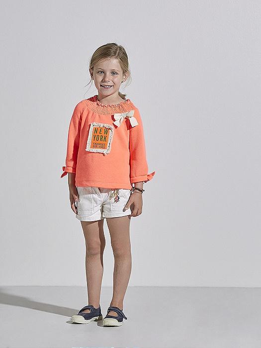 Conjunto de niña con pantalón corto y sudadera naranja Nanos